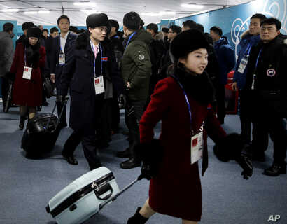 Members of the North Korean Olympic delegation arrive at the Olympic Village of the 2018 Winter Olympics in Gangneung, South Korea, Feb. 1, 2018.