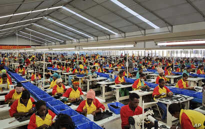 Ethiopian factory workers make shoes at Chinese company Huajian's plant in Addis Ababa, Ethiopia, Jan. 5, 2017.  Workers from at Ganzhou Huajian International Shoe City Co., a southeastern China factory used by Ivanka Trump and other fashion brands, ...