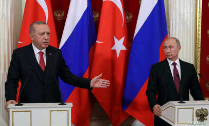 Russian President Vladimir Putin and his Turkish counterpart Recep Tayyip Erdogan attend a news conference after their meeting at the Kremlin in Moscow, Russia, Jan. 23, 2019.
