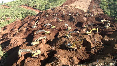 FILE - Excavators search for bodies in Hpakant, Kachin State, Myanmar, Nov. 24, 2015. Dozens of people are missing and feared dead after a landslide Friday in the same area where at least 100 people died in a similar disaster last month.