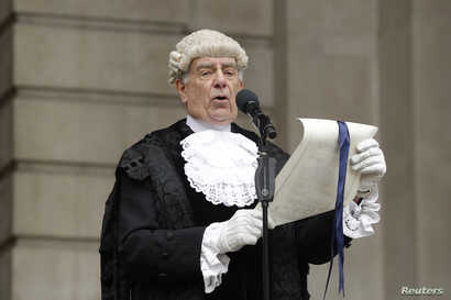 In keeping with traditional practice, Colonel Geoffrey Godbold, the City of London Corporation's Common Cryer and Serjeant-at-Arms reads out the Proclamation of the Summons for a new Parliament on the steps of the Royal Exchange, in the City of Londo...