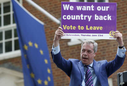 FILE - Nigel Farage, a British politician and leader of the UKIP party, holds up a placard as he launches his party's campaign for Britain to leave the European Union, outside the EU representative office in London, May, 20, 2016.
