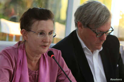 FILE -  Renata Lok-Dessallien, left, the U.N. Resident and Humanitarian Coordinator in Myanmar, and British ambassador to Myanmar Andrew Patrick attend a news conference after a trip to the Maungdaw area in northern Rakhine state in Myanmar, Nov. 3, ...