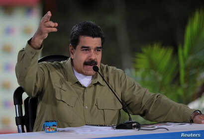 "Venezuela's President Nicolas Maduro speaks during his weekly broadcast ""Los Domingos con Maduro"" (The Sundays with Maduro) in Caracas, Venezuela Aug. 6, 2017."