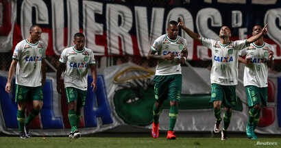 Players of Brazil's Chapecoense celebrate a goal against San Lorenzo in Buenos Aires, Argentina, Nov. 2, 2016.