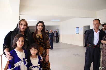 Payman Salih, her daughters and her husband, Sanger Abuzaid, say they hope the vote will signify an abrupt change in government policies impacting their region on May 12, 2018 in Irbil, Kurdistan Region, Iraq. (H.Murdock/VOA)