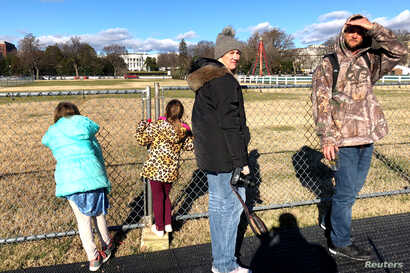 Tourists and visitors are unable to visit the National Christmas Tree near the White House in Washington because of its closure by the National Park Service, Dec. 22, 2018. The closure was made necessary by a partial federal government shutdown.