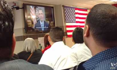 """The new U.S. citizens received a personal greeting from U.S. President Barack Obama, on a plasma screen TV. """"You can help write the next great chapter in our American story,"""" Obama said. """"I'm proud to welcome you as a new citizen of this coun..."""