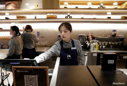 Baristas work at a Luckin Coffee store in Beijing, China, July 17, 2018.