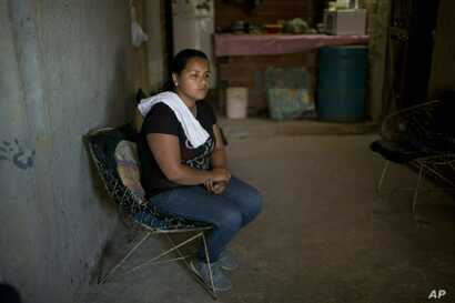 """Marvelis Sinai, cousin of Jhonny Godoy, said """"I'm going to continue demonstrating because I learned it from my cousin."""" Sinai works for an opposition politician who hands out free food in the slums. """"He died so we can have a free Venezuela."""""""