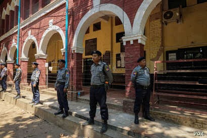 Police guard the courtroom in Yangon's Insein Township where reporters Wa Lone and Kyaw Soe Oo are on trial.