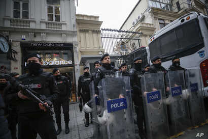Riot police stand outside the Netherlands consulate as the supporters of Turkey's President Recep Tayyip Erdogan stage a protest in Istanbul, March 11, 2017.