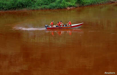Members of a rescue team use a boat on Paraopeba River as they search for victims of a collapsed tailings dam owned by Brazilian mining company Vale SA, in Brumadinho, Brazil, Feb. 4, 2019.