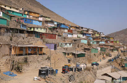 FILE - Houses are seen at a hill in the shanty town Nueva Esperanza on the outskirts of Lima, Peru, March 28, 2018.