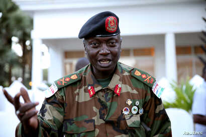 FILE - Army chief General Ousman Badjie is pictured as he arrives at the mediation meeting with the West African delegation on election crisis, in Banjul,  Dec. 13, 2016.