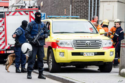 Armed police guard a street in Brussels on Nov. 16, 2015.