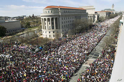 "People fill Pennsylvania Avenue during the ""March for Our Lives"" rally in support of gun control in Washington, March 24, 2018."