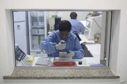 A graduate student analyzes samples to identify the Zika virus in a laboratory at the Fiocruz institute in Rio de Janeiro, Brazil, Jan. 22, 2016.