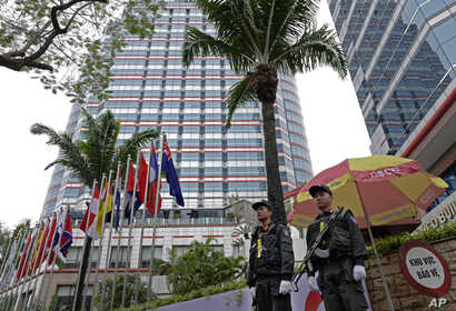 Police officers stand guard in front of the Melia Hotel in Hanoi, Vietnam, Feb. 25, 2019 ahead of the second summit between U.S President Donald Trump and North Korean leader Kim Jong Un.