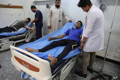 Injured protesters receive treatment at a hospital in Basra, Iraq, Sept. 9, 2018.