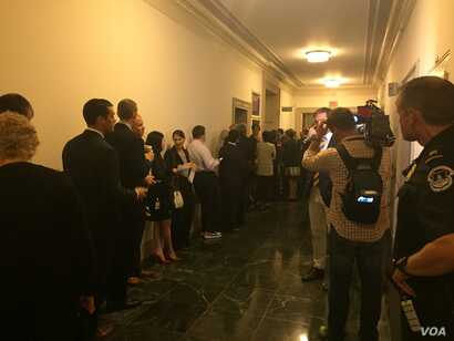 The hallway outside the hearing room where former U.S. Secretary of State Hillary Clinton will testify Thursday before the Republican-led special House committee investigating the deadly 2012 attack on the U.S. consulate in Benghazi, Libya, in Washin...
