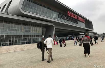FILE - Passengers arrive to purchase tickets for the Standard Gauge Railway (SGR) line constructed by the China Road and Bridge Corporation (CRBC) and financed by Chinese government at the Nairobi Terminus in the outskirts Nairobi, Kenya, July 28, 20...