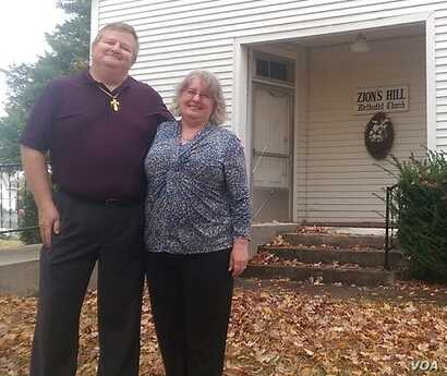 Pastor Dan Sweet and his wife, Joy, in front of Zion Hill United Methodist Church