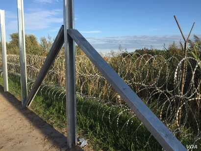 Hungary is fortifying its border with Serbia with razor wire.