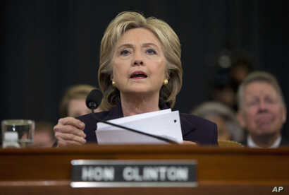 Democratic presidential candidate, former Secretary of State Hillary Rodham Clinton looks toward the dais as she settles into her seat prior to testifying before the House Benghazi Committee, on Capitol Hill in Washington, Oct. 22, 2015.