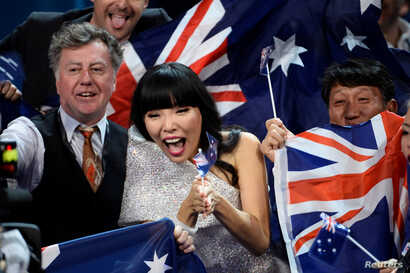 Australia's Dami Im cheers in the Green Room during the Eurovision Song Contest final at the Ericsson Globe Arena in Stockholm, Sweden, May 14, 2016.
