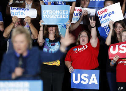 Supporters react as Democratic presidential candidate Hillary Clinton speaks during a rally at Theodore Roosevelt High School, Oct. 28, 2016, in Des Moines, Iowa.