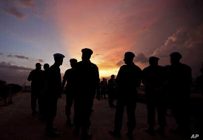 FILE - This photo shows silhouettes of U.N. peacekeepers from Brazil at the airport in Port-au-Prince, Haiti, July 11, 2011. According to an AP investigation, some 150 allegations of abuse and exploitation were reported in Haiti between 2004 and 2016...