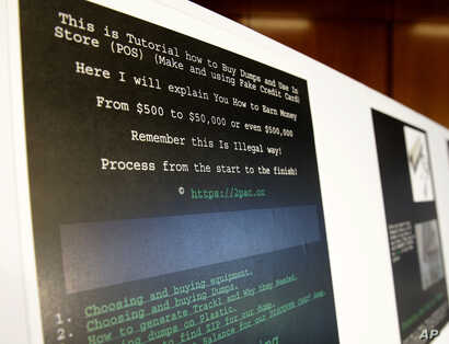 A screenshot of a tutorial posted online by Russian hacker Roman Seleznev on how to steal credit card data is displayed for reporters, April 21, 2017, in Seattle, following the federal court sentencing of Seleznev to 27 years in prison after he was ...