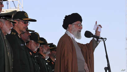 In this picture released by official website of the office of the Iranian supreme leader, May 10, 2017, Supreme Leader Ayatollah Ali Khamenei speaks during a graduation ceremony of a group of the Revolutionary Guard cadets in Tehran, Iran. Khamenei w...
