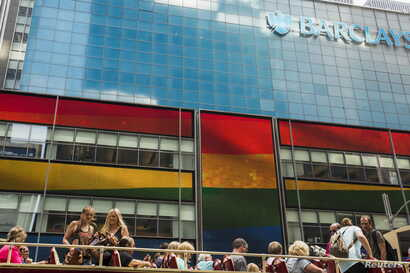 FILE - Tourists on a bus move past a Barclays building as the LGBT rainbow flag is displayed on its digital screens in New York, June 26, 2015. The U.S. Supreme Court had just ruled that constitutional guarantees meant states could not ban same-sex m...