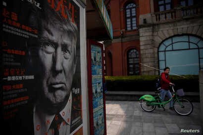 A Chinese magazine poster showing U.S. President Donald Trump is displayed at a newsstand in Shanghai, China March 21, 2017.