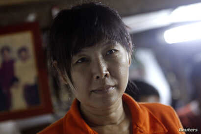 Than Dar, the wife of slain journalist Par Gyi, is seen during a Reuters interview at her home, in Yangon, Myanmar, Oct. 28, 2014.