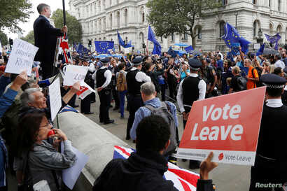 """FILE - Brexit supporters form a counter demonstration as Pro-Europe demonstrators protest during a """"March for Europe"""" against the Brexit vote result earlier in the year, in London, Britain, Sept. 3, 2016."""
