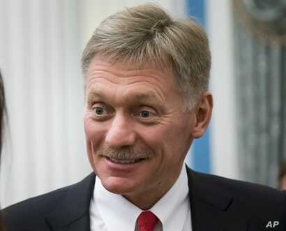 FILE - In this Friday April 6, 2018 file photo, Russian President Vladimir Putin's spokesman Dmitry Peskov smiles after a presentation ceremony for presidential awards to young people in the Kremlin, Moscow, Russia.