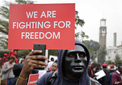 Kenyan activists and civil society groups protest in solidarity with Ugandan pop star-turned-lawmaker Kyagulanyi Ssentamu, also known as Bobi Wine, in a march to the Ugandan embassy in Nairobi, Kenya, Aug. 23, 2018.