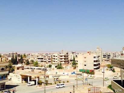 Qamishli is the largest city in a part of Syria that has been largely untouched by the war against Islamic State. (M. Civiroglu/VOA)
