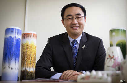 FILE - Jian Yang, a New Zealand lawmaker who was born in China, speaks Jan. 26, 2016, in Auckland, New Zealand. Yang said in a statement Sept. 13, 2017, that he's loyal to his new home after media reported he'd spent a decade at top Chinese military...