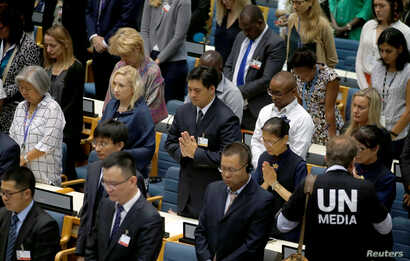 Delegates at the United Nations Environment Programme (UNEP) world environmental forum observe a minute's silence in memory of the victims of Ethiopian Airlines Flight ET 302 plane crash, at the UN complex within Gigiri in Nairobi, Kenya, March 11, 2...