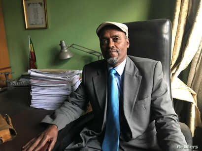 FILE - Ethiopian lawyer Wondimu Ebsa, who represented political prisoners detained during unrest in the country over the past three years, poses for a photograph during a Reuters interview in his office in Addis Ababa, Ethiopia, July 25, 2018.