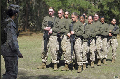 FILE - Female recruits stand at the Marine Corps Training Depot on Parris Island, South Carolina, Feb. 21, 2013.
