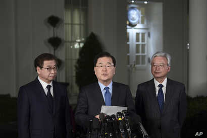 South Korean national security director Chung Eui-yong, center, speaks to reporters at the White House in Washington, March 8, 2018, as intelligence chief Suh Hoon, left and Cho Yoon-je, the South Korea ambassador to United States listen. President D...