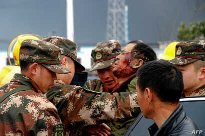 Paramilitary police officers transfer an injured man after an explosion in Yancheng in China's eastern Jiangsu province, March 21, 2019.