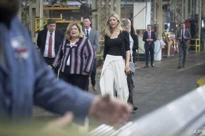FILE - Ivanka Trump, daughter of then-Republican presidential candidate Donald Trump, center, tours Middletown Tube Works, a welded steel tube supplier, alongside owner Angela Phillips, left, in Middletown, Ohio, Oct. 6, 2016.