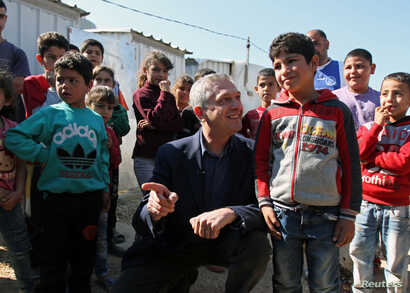 United Nations High Commissioner for Refugees (UNHCR) Filippo Grandi meets with Syrian refugee children, during his visit to an informal settlement in Mohammara, Akkar Governorate, Lebanon, March 9, 2019.