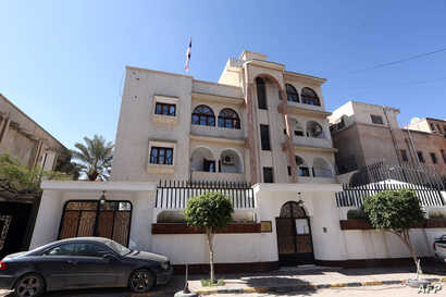 FILE - A view of the Serbian Embassy in Tripoli, Libya, Feb. 21, 2016. The day before, Libya's internationally recognized government condemned a U.S. airstrike west of Tripoli in Sabratha, believed to have killed Islamic State operative Noureddine Ch...